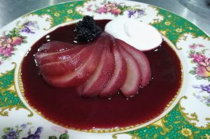 A dessert of poached pears in blackberrys as served on an Aragon Active Self Guided Walking Holiday Spain