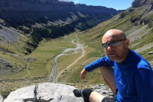 A trail runner poses at the head of the Ordesa valley on Aragon Active Trail Running Holiday