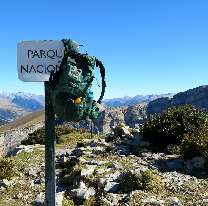 A rucsac on the Ordesa National Park sign with a panoramic view on Aragon Active Self Guided Walking Holiday Spain