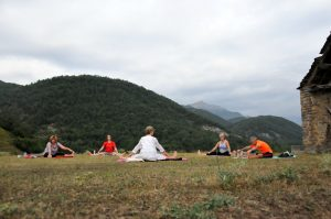 A strech out for the yogis in an outdoor class in the Pyrenees on the Yoga Meditation Retreat Spain with Aragon Active