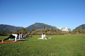 Morning yoga class outside in the Pyrenees with Aragon Active on the Yoga Meditation Retreat Spain