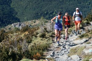 Trail runners walking a steep section in the Pyrenees on Aragon Active Trail Running Holiday