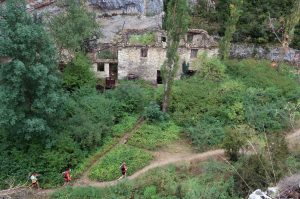 Trail runners passing through an abandoned village in the Pyrenees on Aragon Active Trail Running Holiday