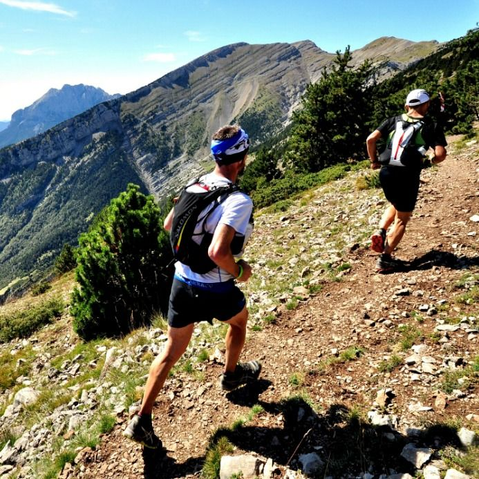 Two trail runners going uphill in the Pyrenees on Aragon Active Trail Running Holiday